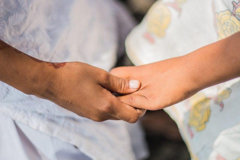 grieving pet parent - holding hands
