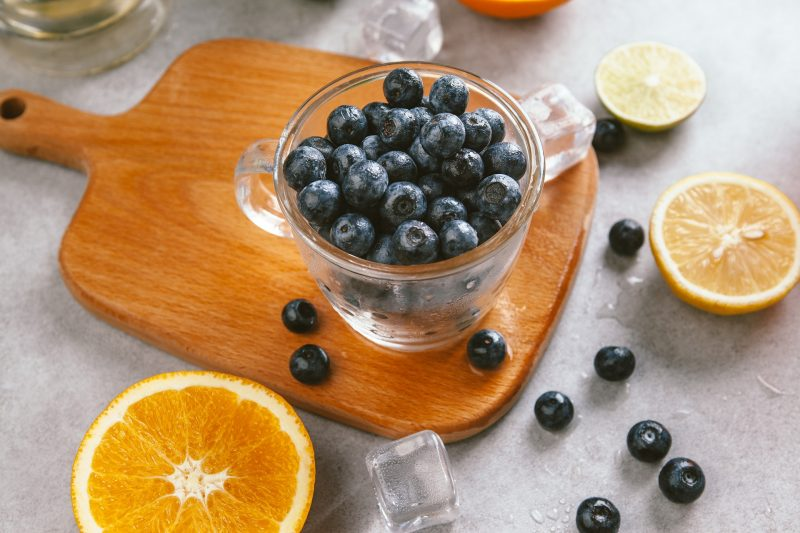 blueberries in a bowl on a chopping board