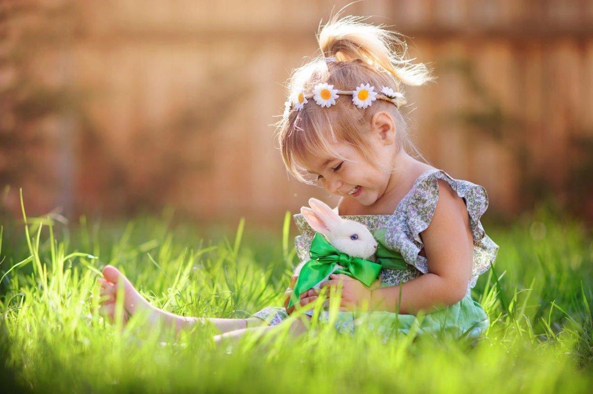 Girl and rabbit hug